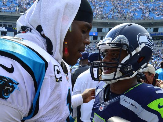635563339501356945-cam-newton-and-russell-wilson